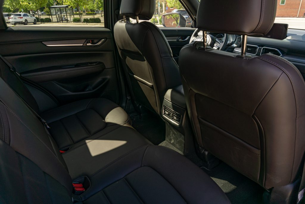The brown Nappa leather interior of the 2020 Mazda CX-5 Signature AWD as seen from the rear seats