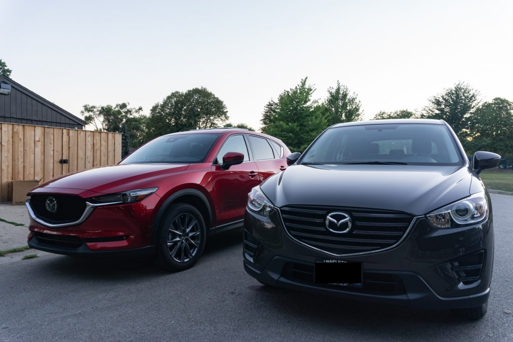 A red 2020 Mazda CX-5 Signature vs. a gray 2016 Mazda CX-5 Sport
