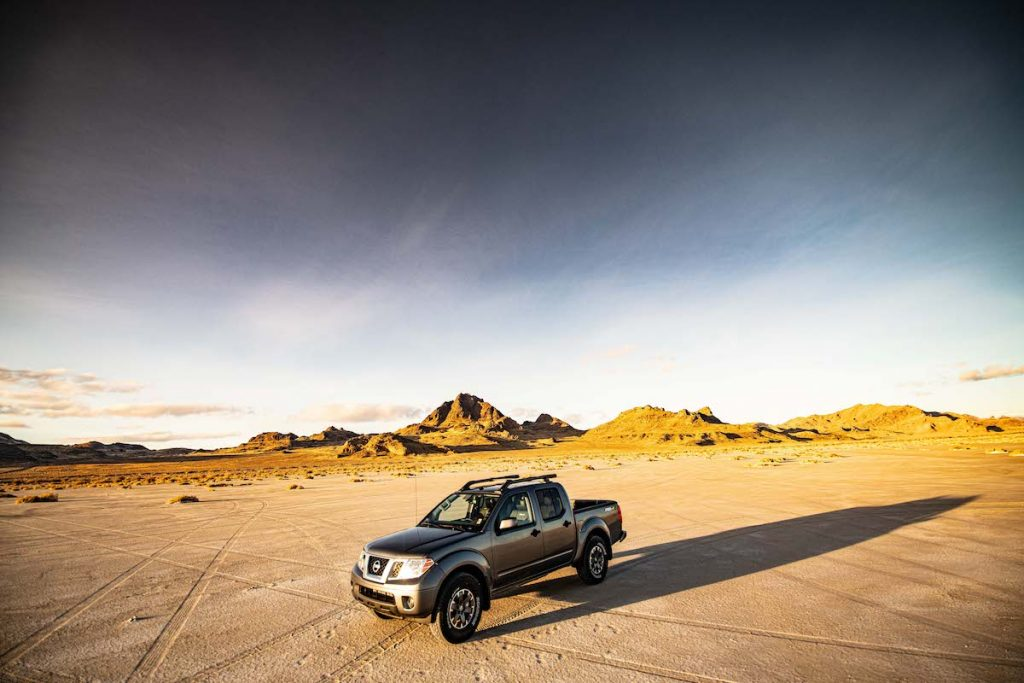 2020 Nissan Frontier driving through the desert