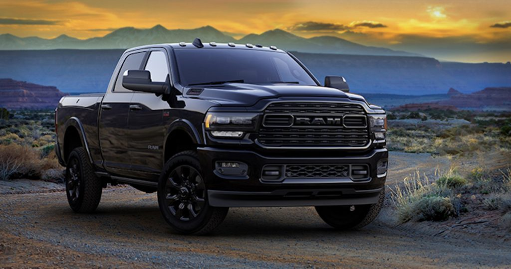 New 2020 Ram Heavy Duty Limited Black in the desert with a colorful sunset sky