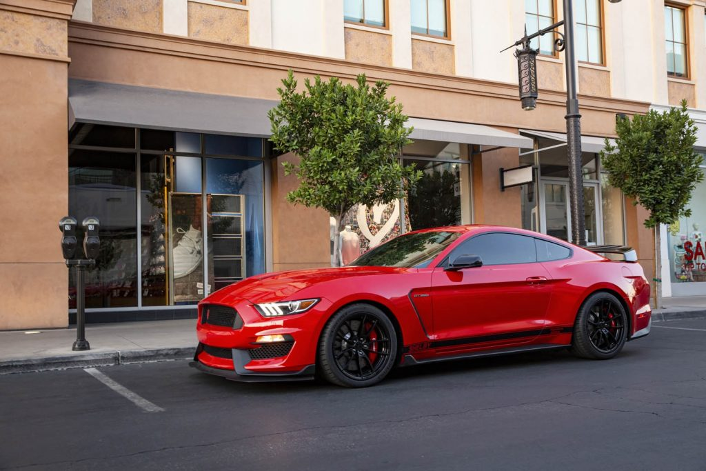 A red 2020 Shelby American Ford Mustang GT350 Anniversary Edition parked on the street
