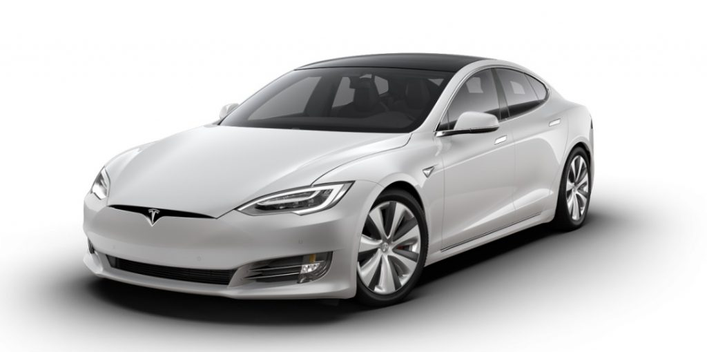 a sleek Tesla Model S press photo against a white backdrop