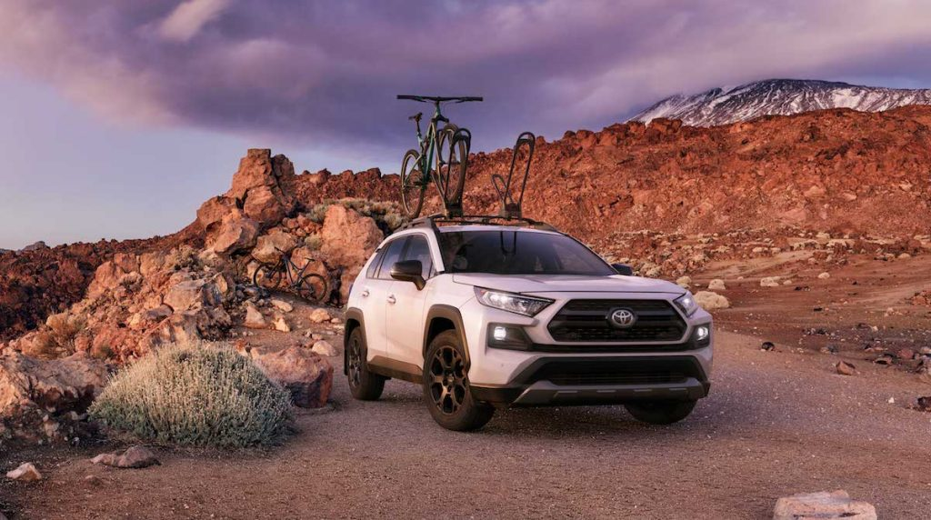 2020 Toyota RAV4 Off Road in the desert on a trail with the bike on the roof rack ready for adventure