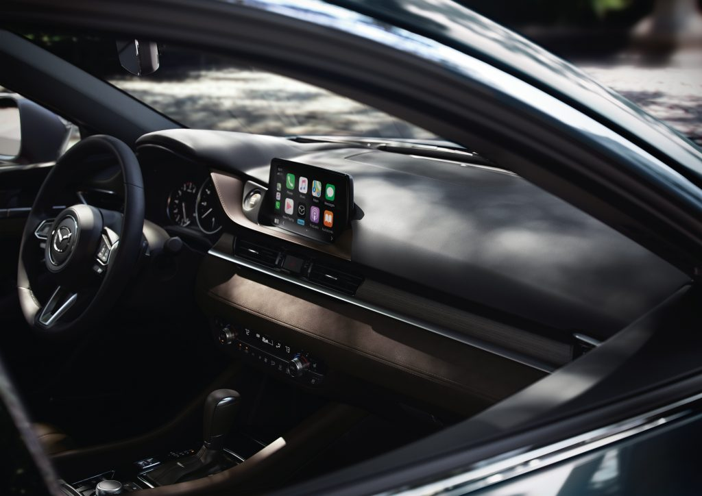 A view of the the Mazda6's interior through the right passenger window.