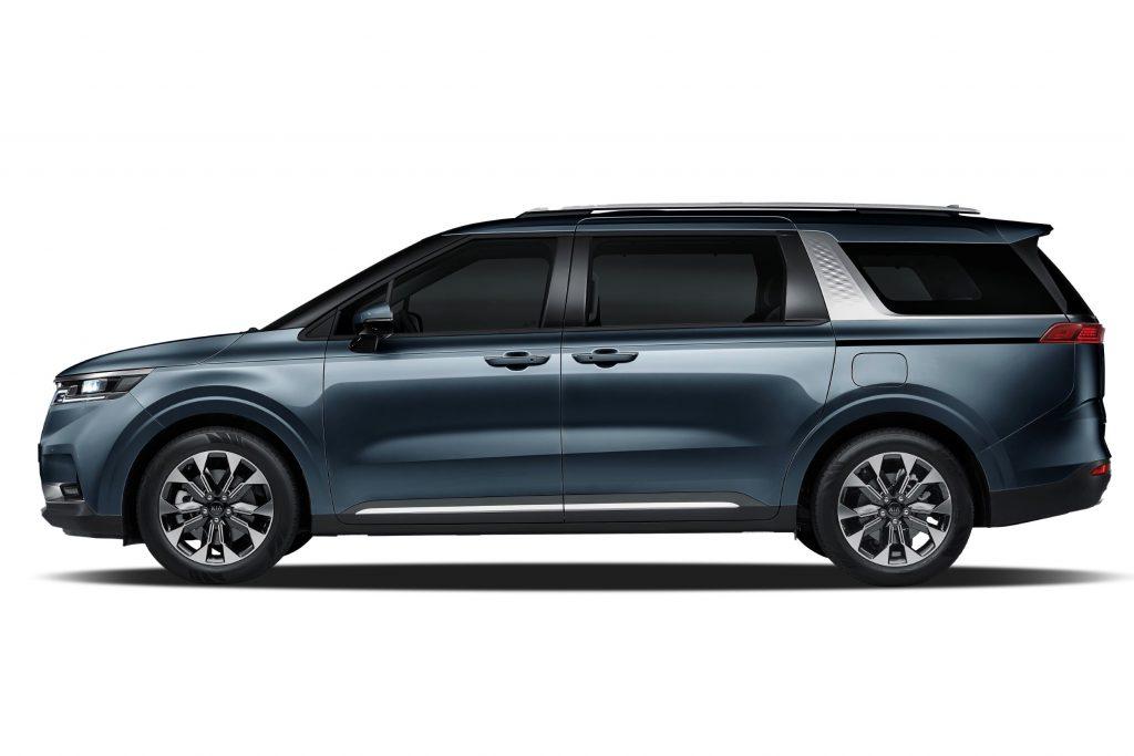 A profile view of a gray 2021 Kia Sedona minivan.