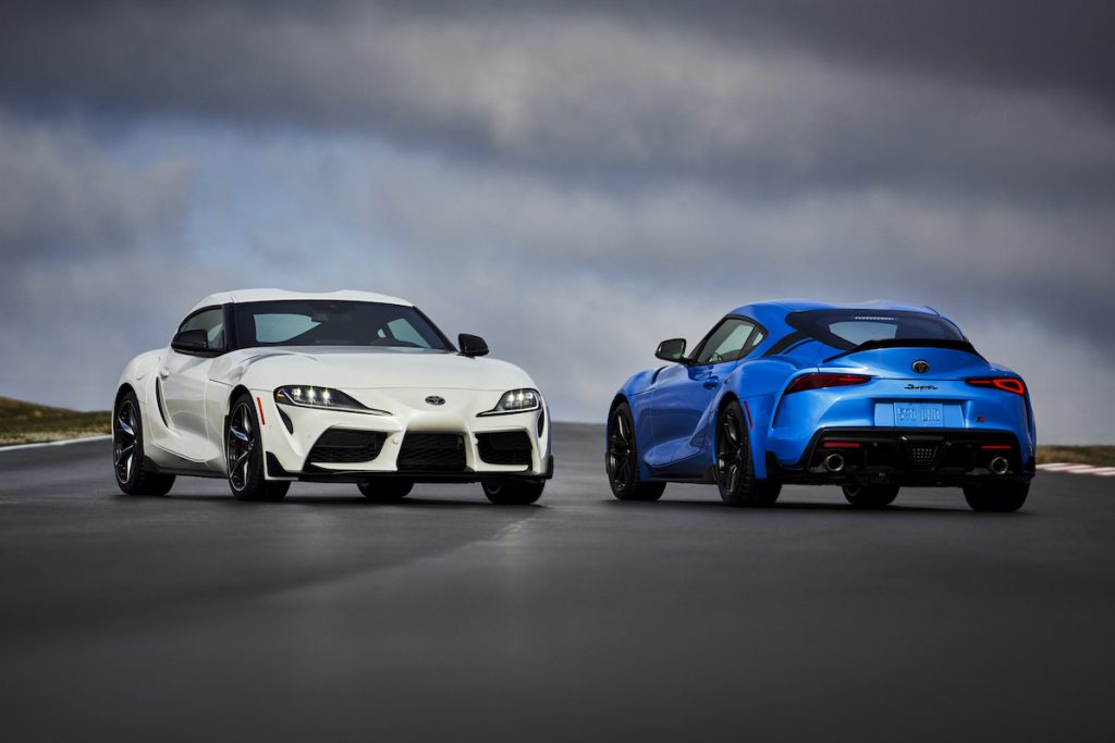 2021 Toyota GR Supra in blue and white parked on a track with overcast skies