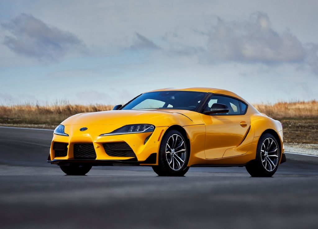 A yellow 2021 Toyota Supra 2.0 parked on a racetrack