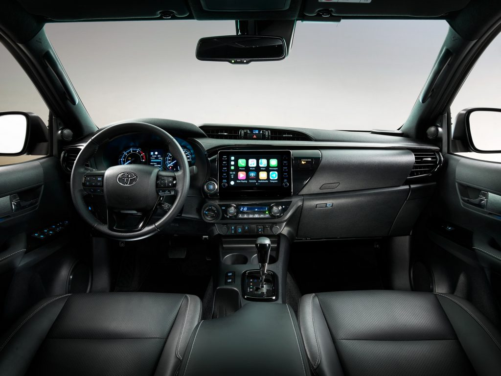 the interior of an Invincible hilux shows the upgraded display and plush leather isn't available in the US