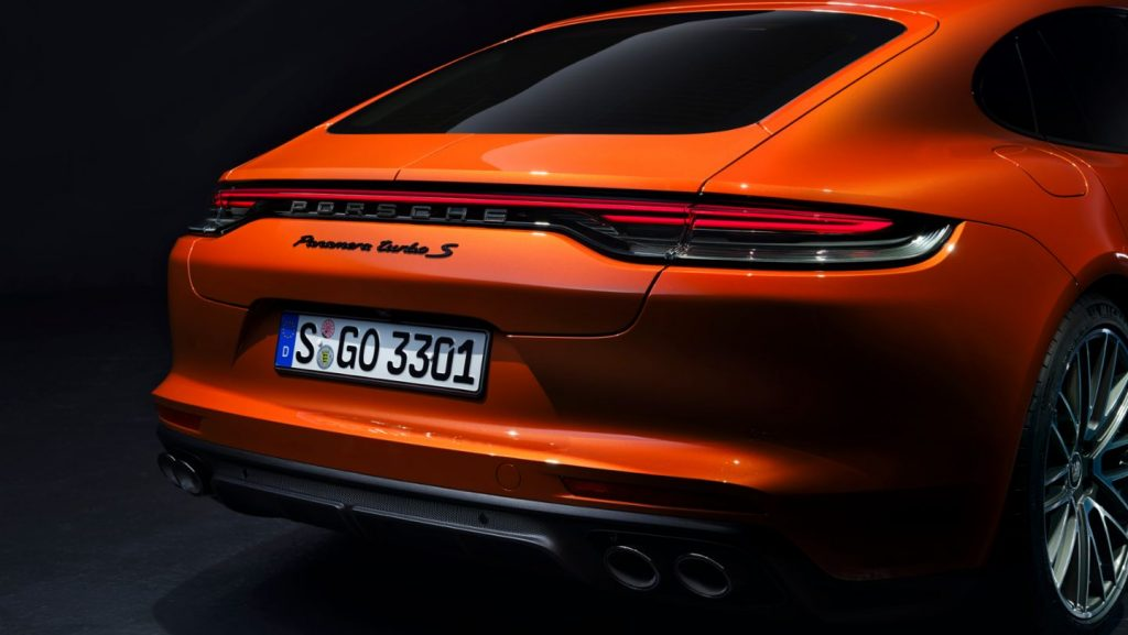 A rear-view of a bright orange 2021 Panamera.