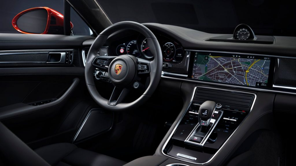 The 2021 Panamera's interior is upscale and comes with a large center display screen.