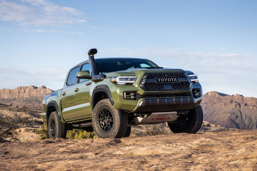 Toyota Tacoma TRD Pro off-roading in dirt is a smaller but still formidable option compared with larger trucks like the raptor