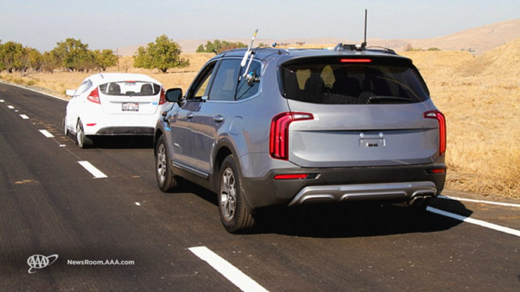 An unmarked silver Kia Telluride follows a simulated disabled vehicle in AAA's 2020 ADAS study