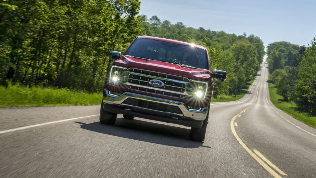 2021 Ford F-150 Lariat driving on country road