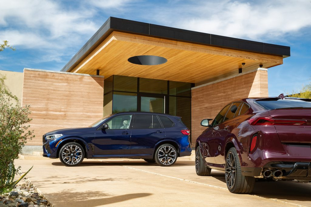 BMW X5 parked under a modern home roof