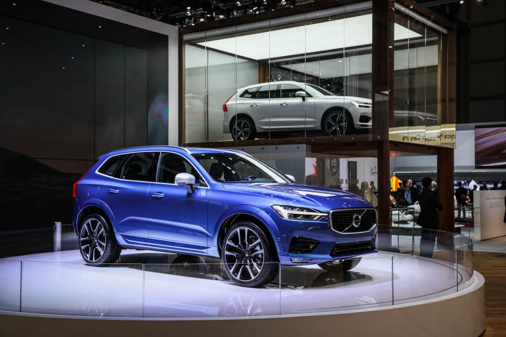 A blue Volvo XC60 on display at an auto show