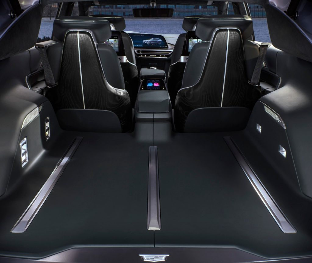 The interior of the Cadillac Lyriq electric SUV is shown from the rear perspective.