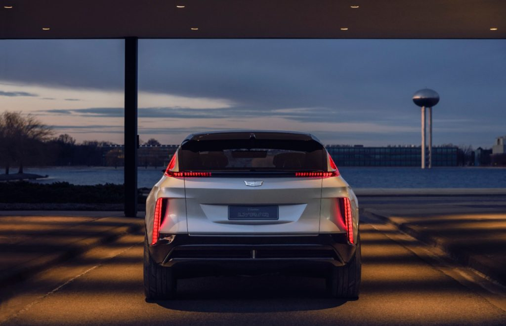 The rear of the electric Cadillac Lyriq bounces off the light at dusk.