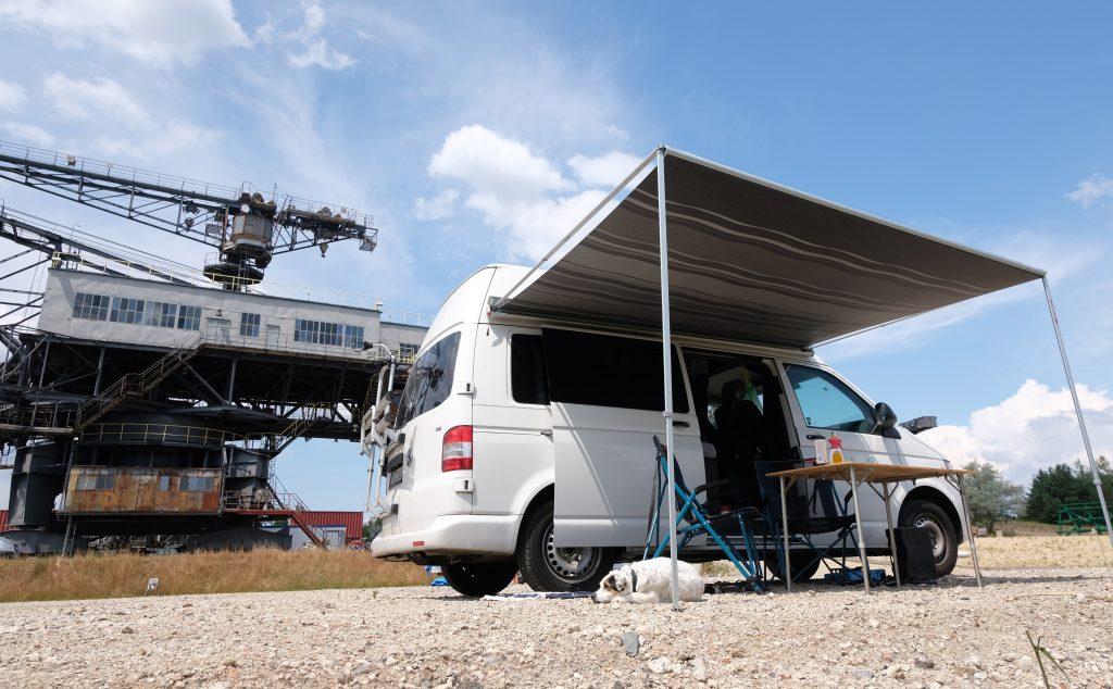 A camper van set up in a field