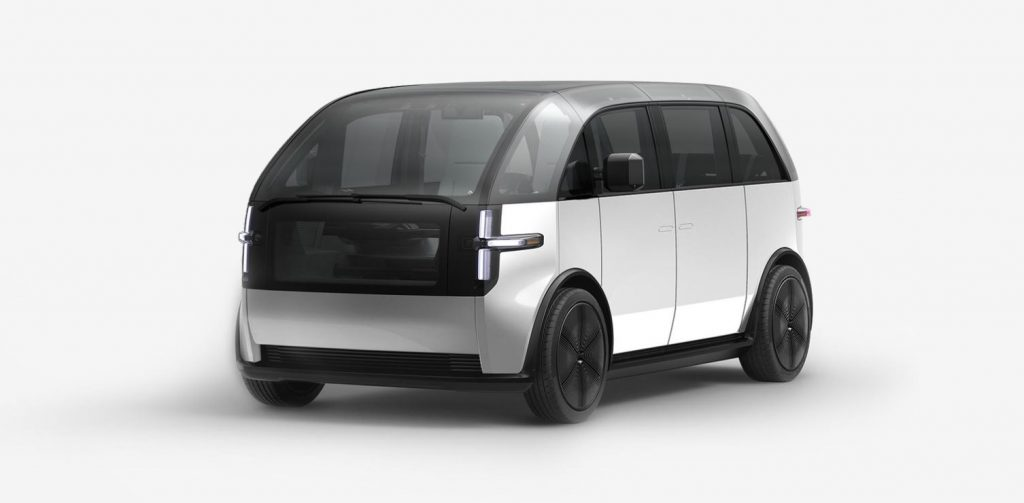 A white Canoo electric van sits in a white background.
