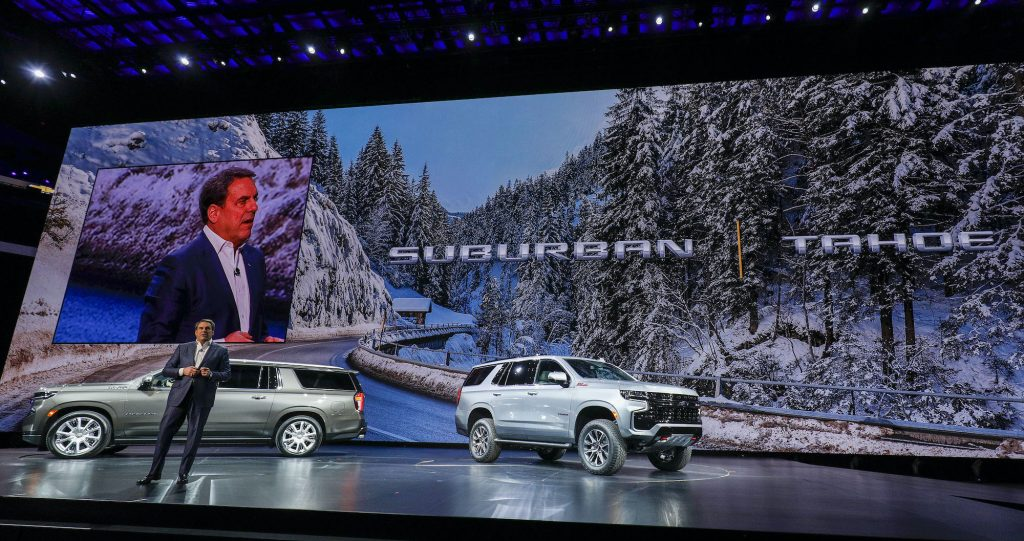 Mark Reuss, President of General Motors, talks about the new 2021 Chevrolet Suburban (left) and 2021 Chevrolet Tahoe (right) SUVs at their reveal at Little Caesars Arena