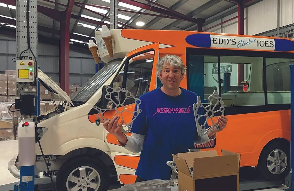 Edd China, former co-host of the Wheeler Dealer television show stands before his EV ice cream truck.