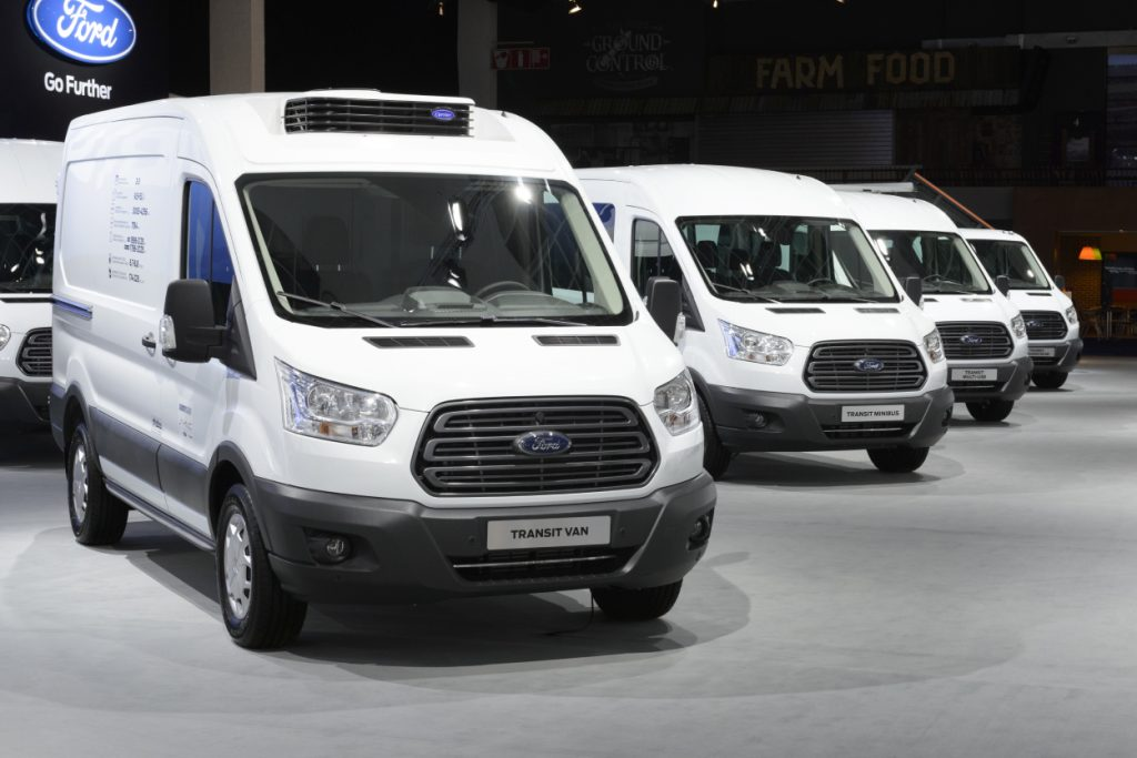 Ford Transit vans on display at an auto show