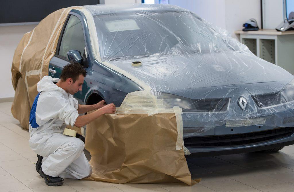 man painting a car