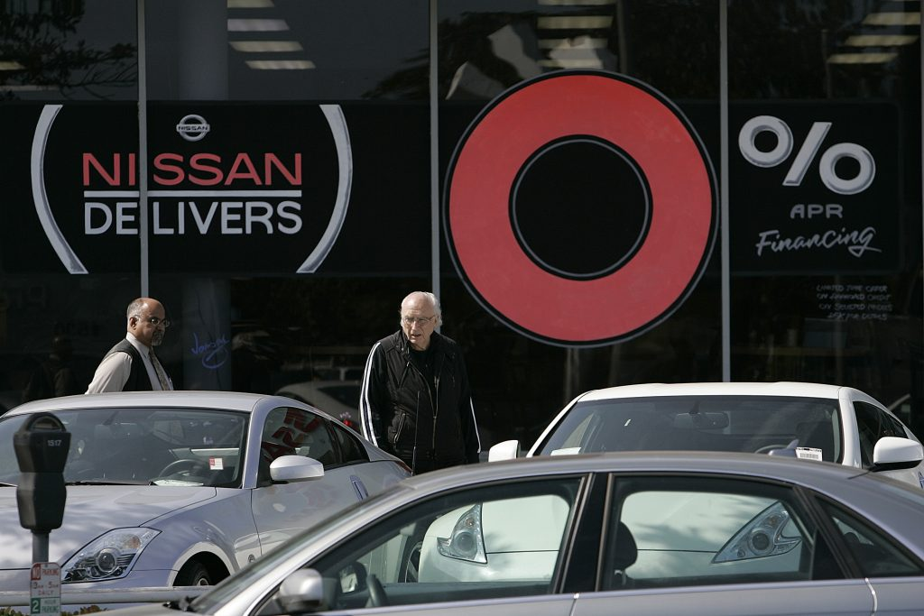 car shoppers shopping at nissan