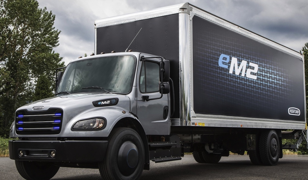 this Daimler electric semi truck is parked with its logos visible