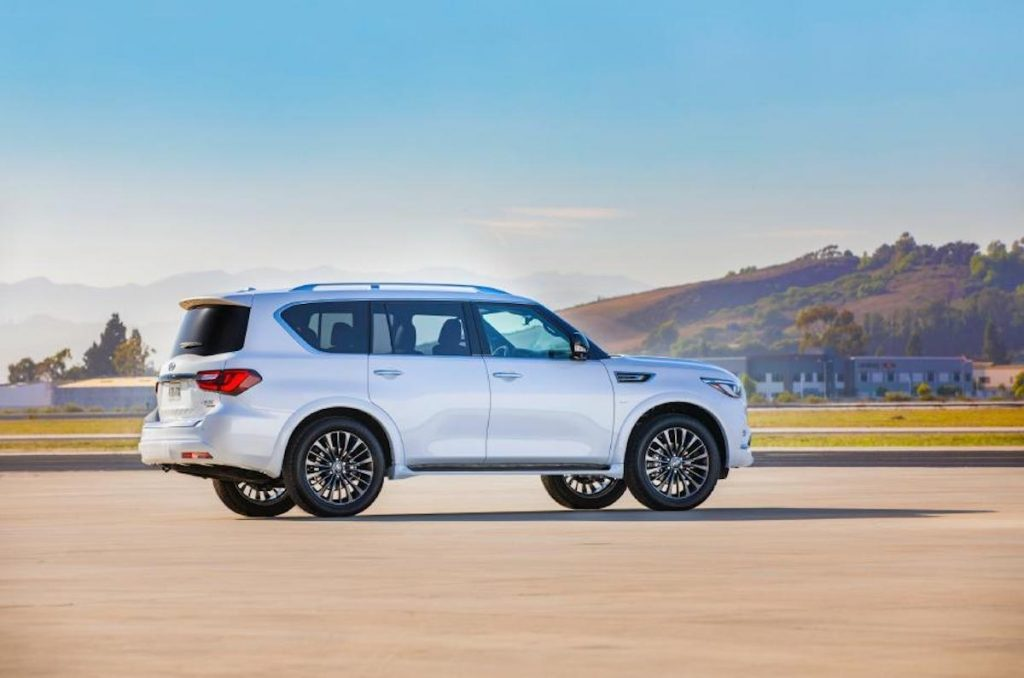 A white Infiniti QX80 on the track.