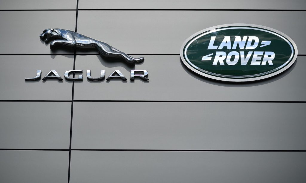 A logo is pictured outside a Jaguar Land Rover new car show room in Tonbridge, south east England