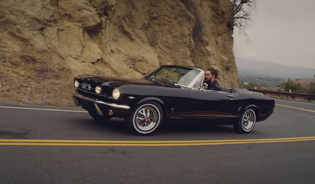 Jason Mamoa drives a black 1965 Ford Mustang GT convertible he had restored for his wife Lisa Bonet.