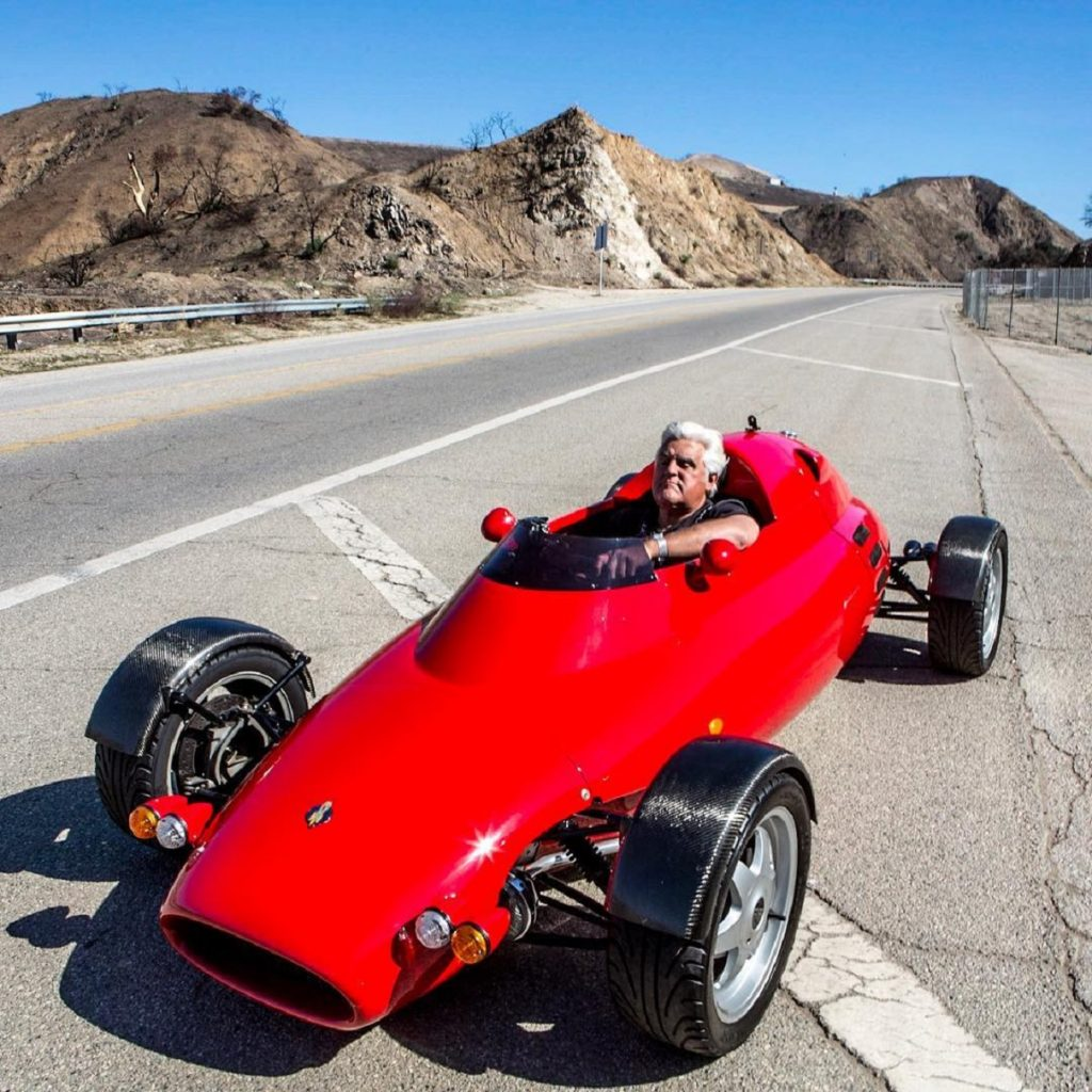 Jay Leno in his Light Car Company Rocket on a California mountain road