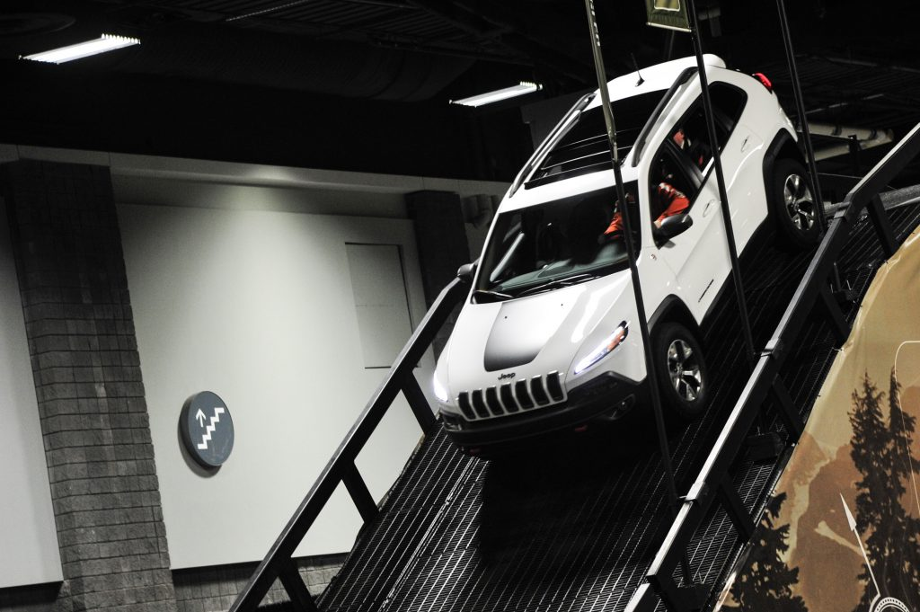 A Jeep Compass on display at an auto show