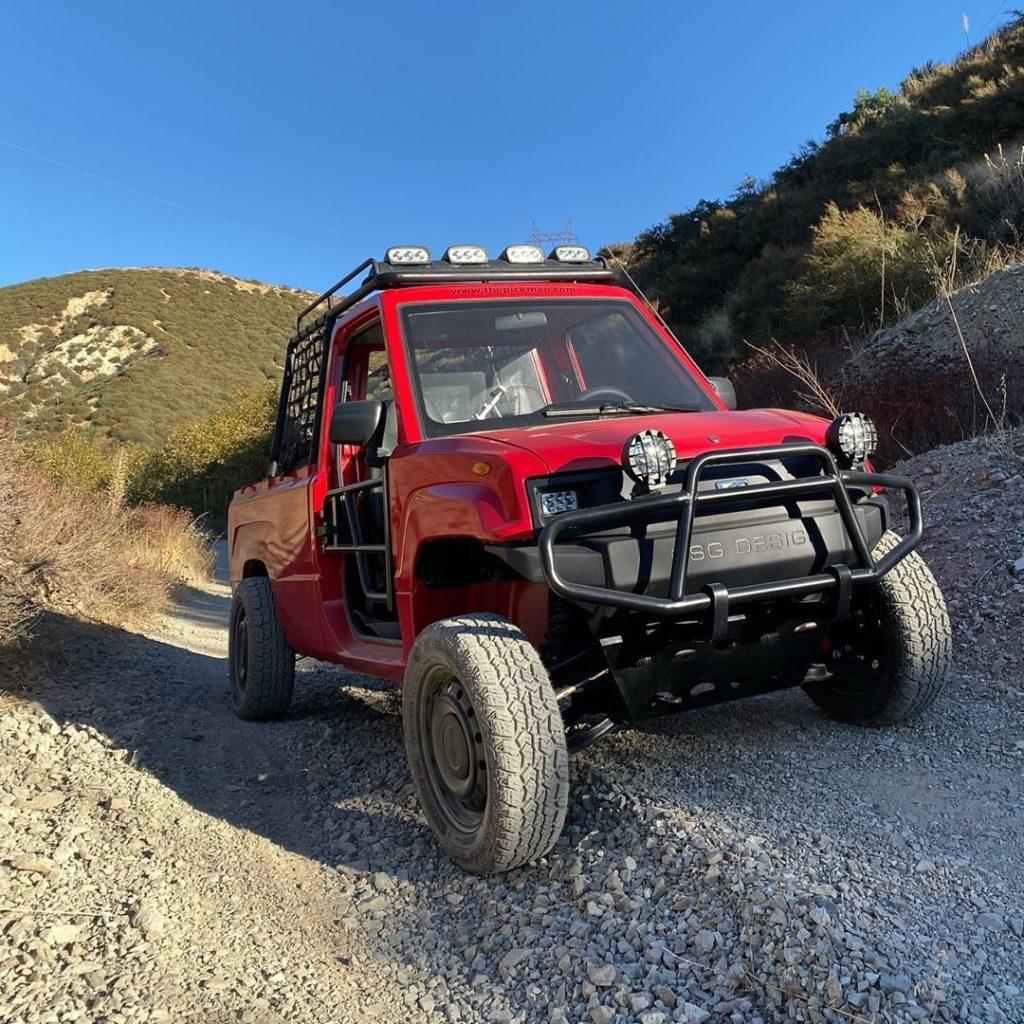 A red Kaiyun Motors Pickman XR on a rocky mountain trail