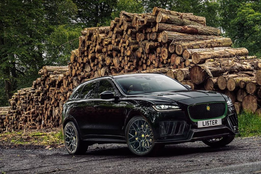 A black Lister Stealth in front of a pile of cut logs