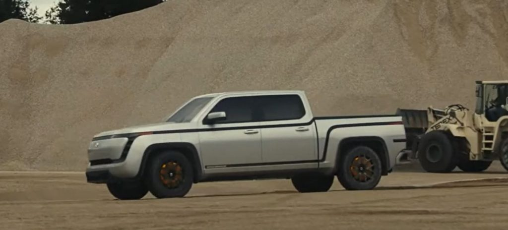 A silver 2021 Lordstown Motors Endurance electric pickup sits in a gravel pit.