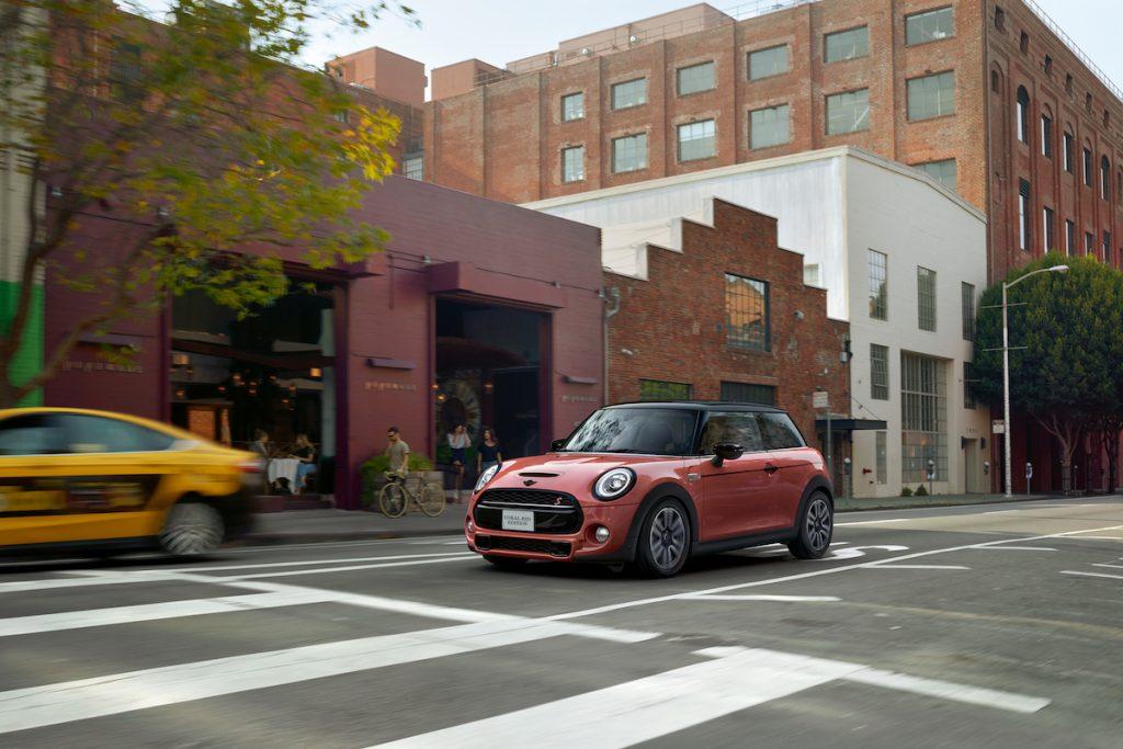 Mini Cooper driving over a crosswalk