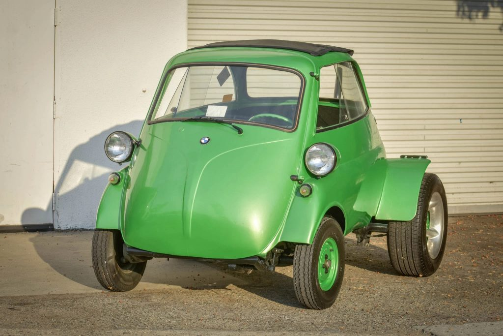 A green 1957 BMW Isetta with a Beetle engine