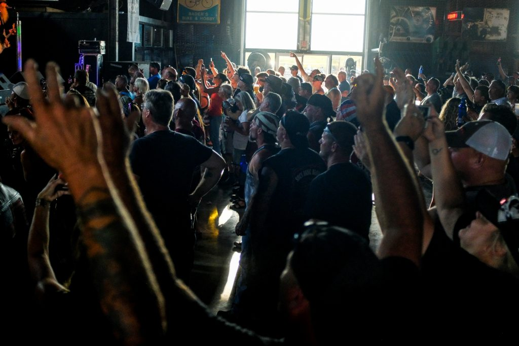 People cheering at a concert during the 80th Annual Sturgis Motorcycle Rally