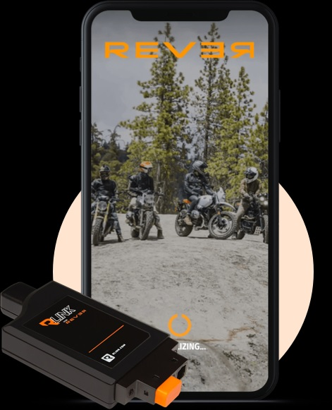An RLINK motorcycle GPS tracker with a smartphone displaying the Rever app