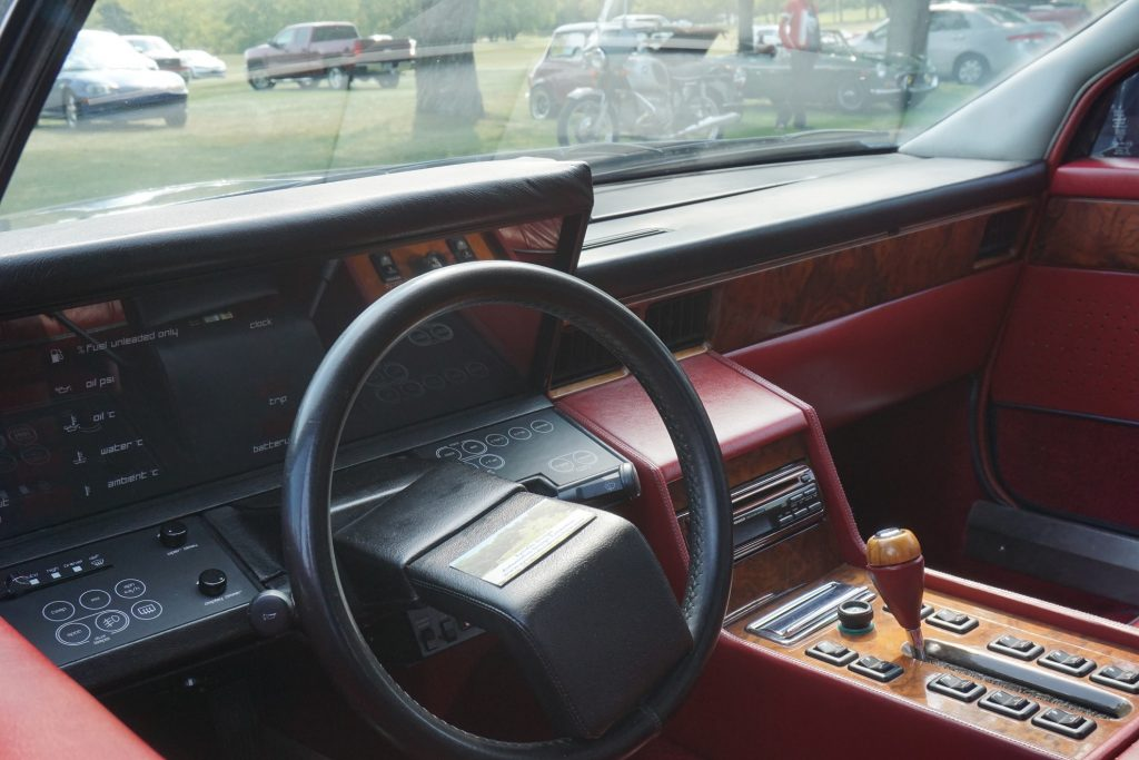 The red-leather interior of an S2 Aston Martin Lagonda, showing the digital dashboard
