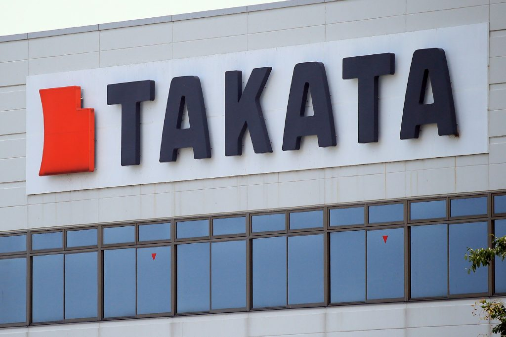 The red and black Takata logo on the side of a building in Japan