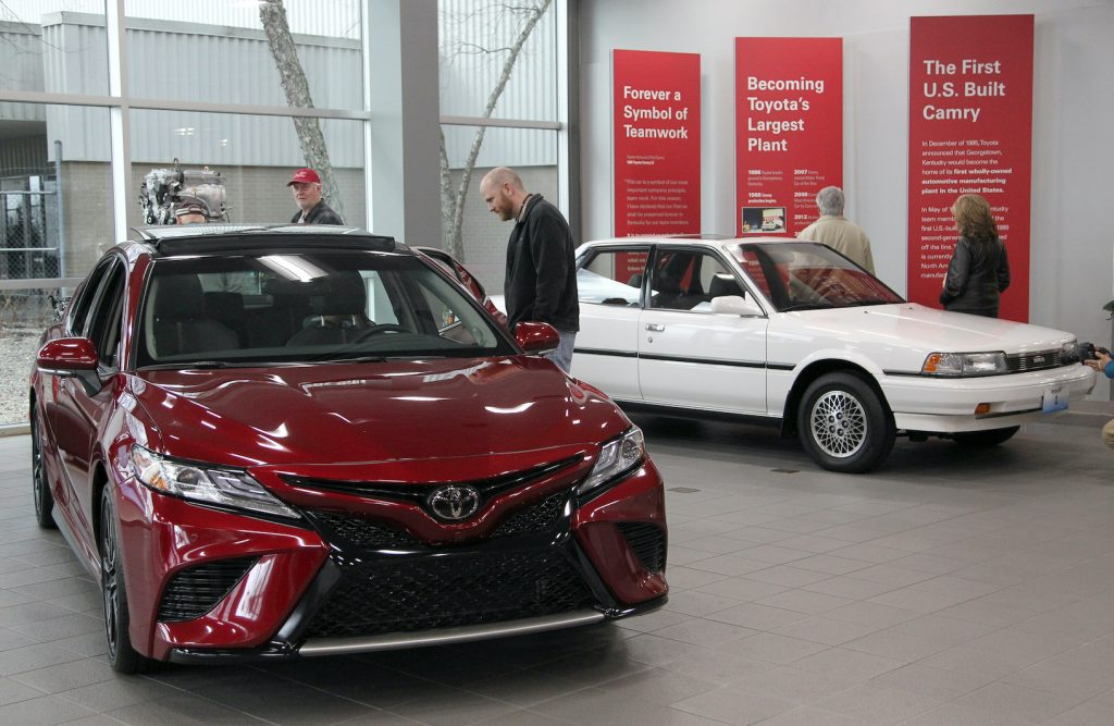 Visitors to the Toyota Motor Manufacturing plant look over the 2019 Toyota Camry, competing with the Honda Accord, at the Georgetown plant as they wait for the unveiling of the new 2019 Toyota RAV4 Hybrid