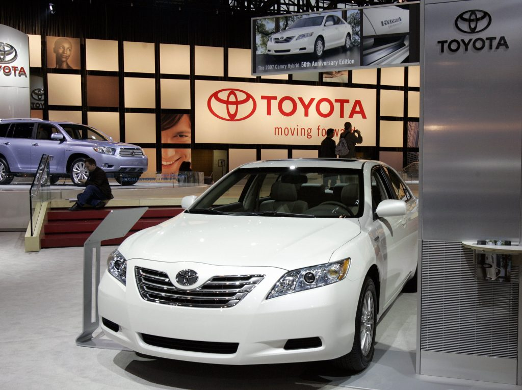 A white Toyota Corolla on display at an auto show