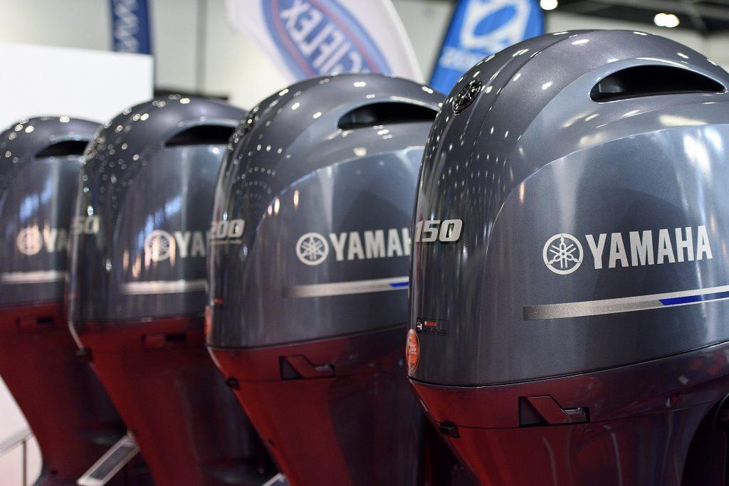 Yamaha outboard motors on display at a boat show