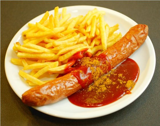 The traditional vW Currywurst with a side of French fries.