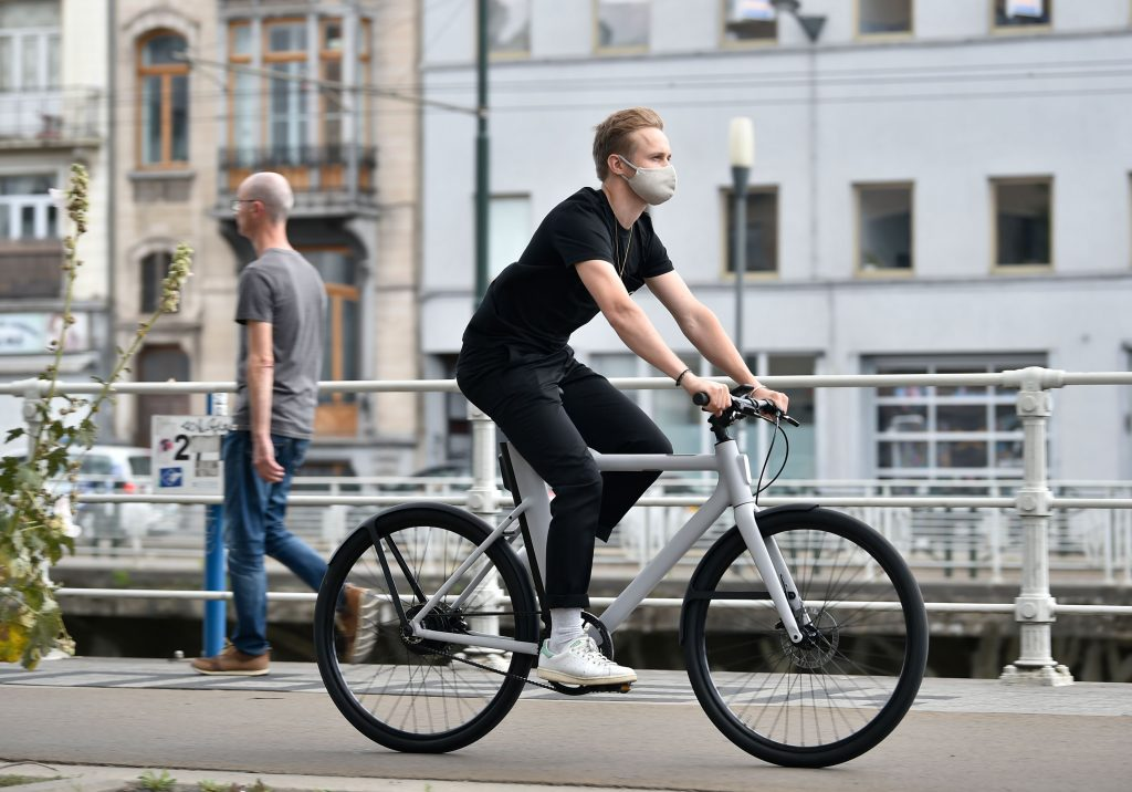 A man rides down the street on an eBike