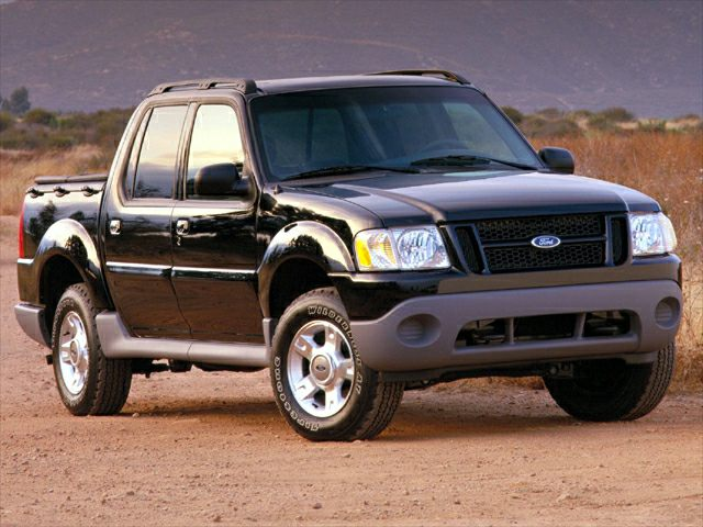 a black Ford Explorer sport trac in a press photo from 2001