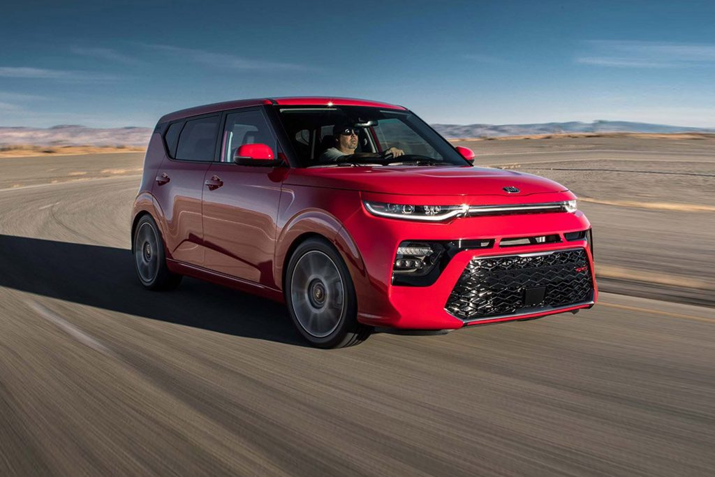A red 2020 Kia Soul going around a corner